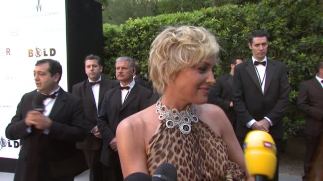 Sharon Stone on being at the show on the importance of the media being at the event and on what she's wearing at the Cannes amfAR's Cinema Against...