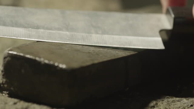 sharpening a knife on stone. - kitchen knife stock videos & royalty-free footage