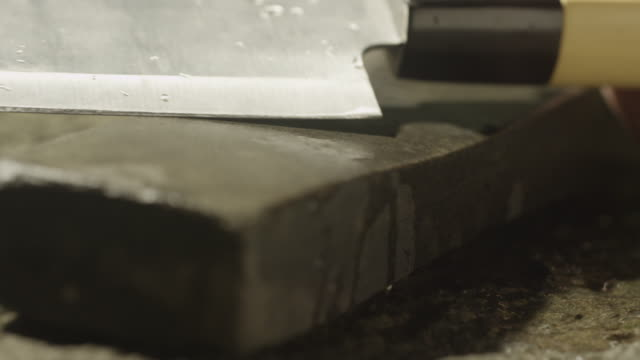 Sharpening a knife on stone.