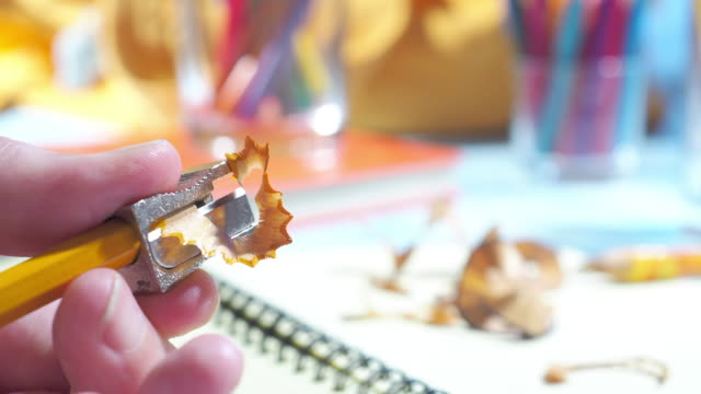 sharpening a pencil on the homework desk - pencil sharpener stock videos & royalty-free footage