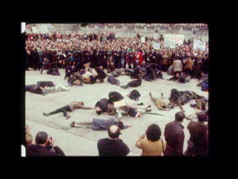 london trafalgar square ext ms sharpeville each letter held up ms crowd standing in front of fountain cms crowd holding up slogans ms troops... - lying on front stock videos & royalty-free footage
