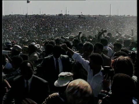 sharpeville massacre anniversary; s africa tlms anc pres nelson mandela along thru crowd at rally to mark anniversary of sharpeville massacre zoom in... - 大量殺人点の映像素材/bロール