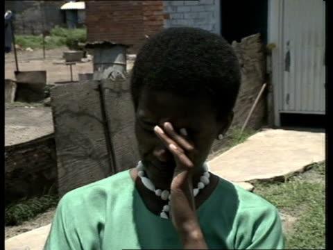 sharpeville six reprieve; south africa: ext cms side regina sefatsa, wife of accused mojalefa reginald sefatsa, along street track l-r cms regina... - law stock videos & royalty-free footage