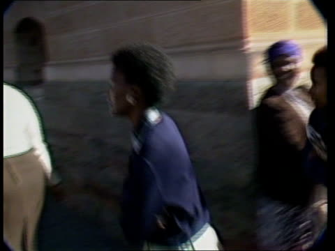 re-trial bid fails; s africa: pretoria: ext tms side relatives of sharpeville six up steps to court l-r tms relatives, including regina sefatsa, wife... - sprinkling stock videos & royalty-free footage