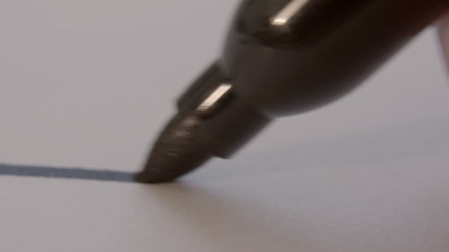 sharpie black marker pen drawing on paper surface 2 - writer stock videos & royalty-free footage