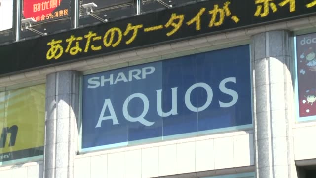sharps shares dive nearly 15 percent after the taiwanese multinational that owns foxconn said it would delay its multi billion dollar takeover to... - disposal container stock videos and b-roll footage
