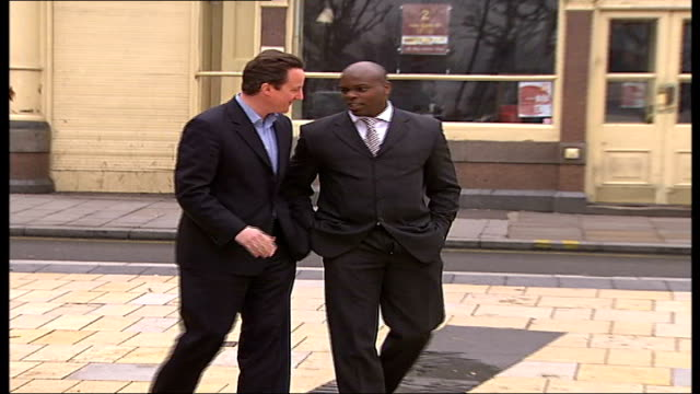 shaun bailey joins conservatives as candidate for hammersmith; england: london: ext shaun bailey greeted by david cameron mp - mp stock-videos und b-roll-filmmaterial