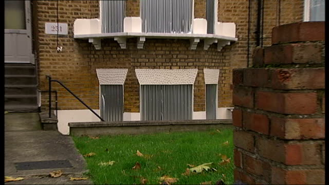 girlfriend jailed for life england london ext boarded up windows of home of karen otmani where she murdered corey - 殺人被害者点の映像素材/bロール