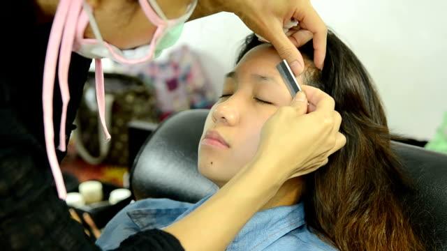 shave eyebrow - eyebrow stock videos & royalty-free footage