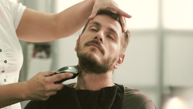 shaving a client with trimmer - electric razor stock videos & royalty-free footage