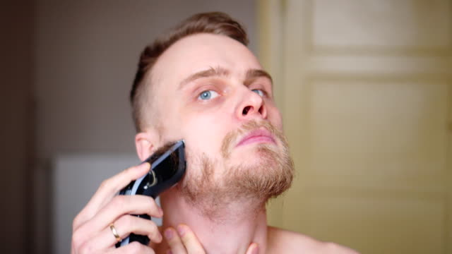 Shaving Face with electric razor Time Lapse