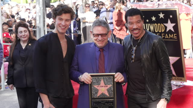 shawn mendes, sir lucian grainge, and lionel richie at sir lucian grainge honored with a star on the hollywood walk of fame on january 23, 2020 in... - ライオネル・リッチー点の映像素材/bロール