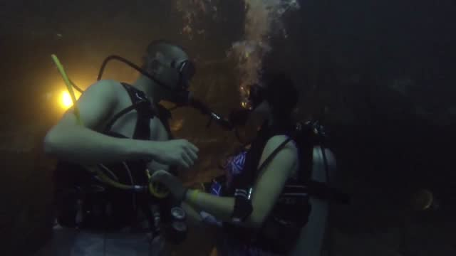 shayla grether was scuba diving with her boyfriend when he shocked her with a surprise underwater proposal. the couple had been dating for nine... - aqualung diving equipment stock videos & royalty-free footage