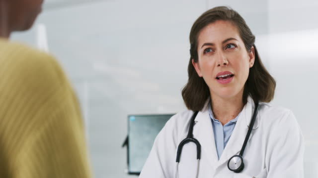 she advises her patients so well - female doctor stock videos & royalty-free footage