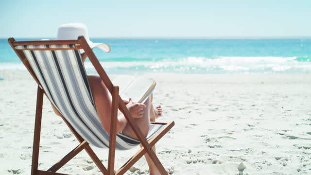 she booked the best spot at the beach - chair stock videos & royalty-free footage