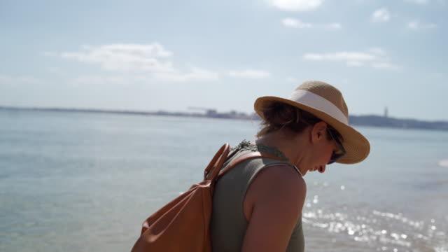 she enjoying long walks on the beach - sun hat stock videos & royalty-free footage