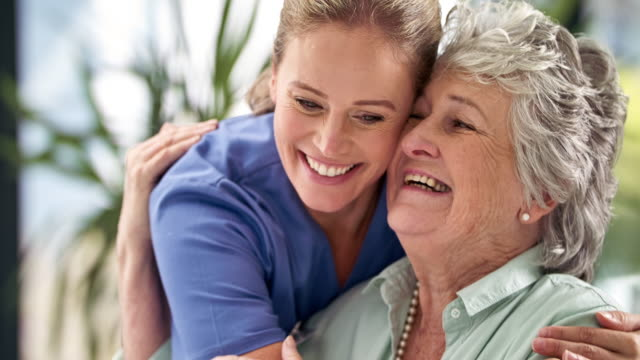 she goes the extra mile to comfort her patients - senior adult stock videos & royalty-free footage