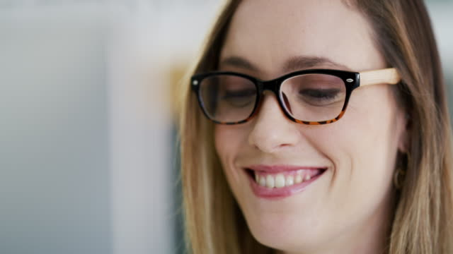 she handles business with a smile on her face - eyewear stock videos & royalty-free footage