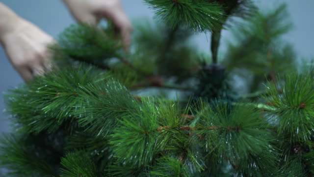 she is decorating the christmas tree. - imitation stock videos & royalty-free footage