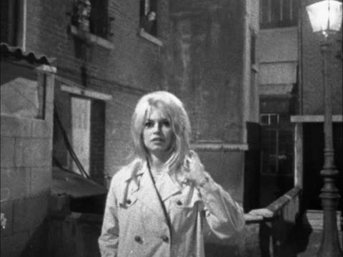 She is filming scenes she was unable to shoot in Britain for her new film The Adorable Idiot / Bardot standing in shop doorway Bardot walks along...