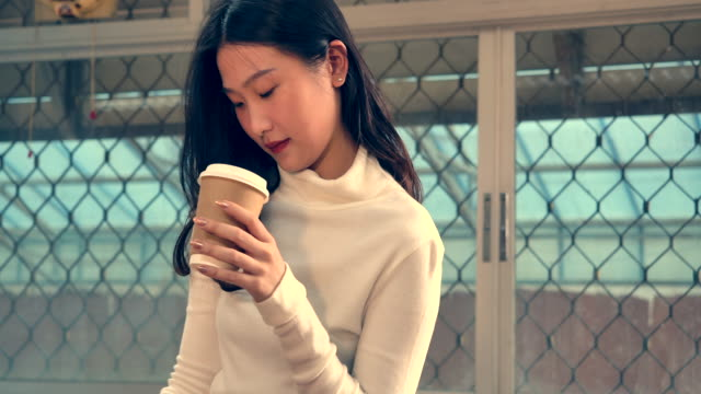 she is reading a notebook and drinking coffee. - coffee drink stock videos & royalty-free footage