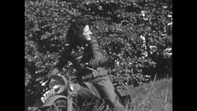 she is riding around in tall grass in a small field home movie shot at a house near muckamore co antrim northern ireland where an raf pilot and his... - one young woman only stock videos & royalty-free footage