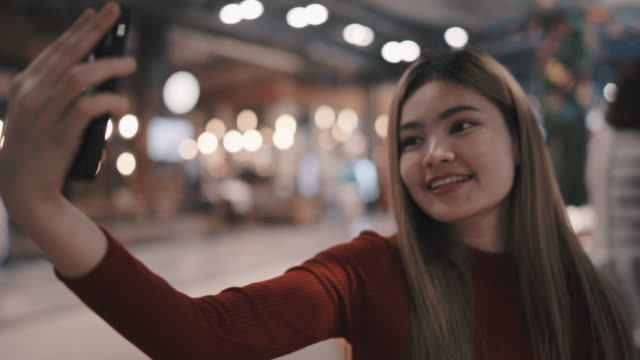 she is selfie during the night at the restaurant. - showing stock videos and b-roll footage