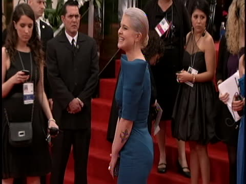 globes she is wearing a blue teal long sleeve gown and her grey hair is up - teal stock videos & royalty-free footage