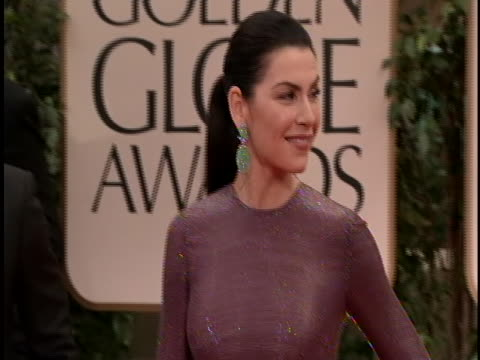 globes she is wearing a long sleeved plum burgundy gown and her hair is up - plum stock videos & royalty-free footage