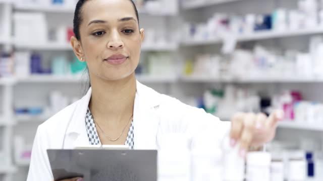 she keeps count of every product in her pharmacy - prescription medicine bottles stock videos & royalty-free footage