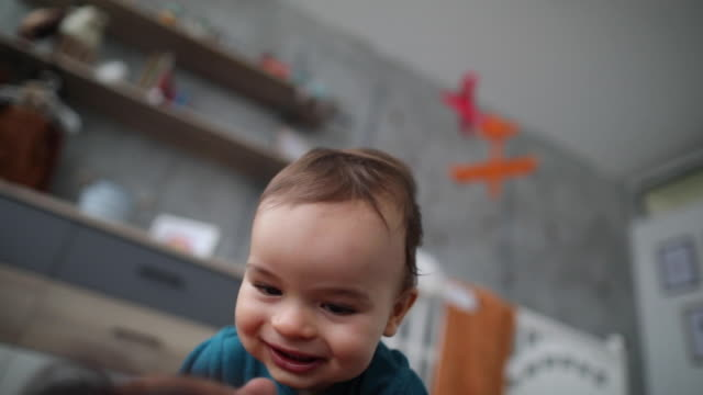 she knows how to make her baby boy smiling - tickling stock videos & royalty-free footage
