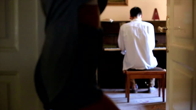 she loves how her boyfriend playing the piano - piano stock videos & royalty-free footage
