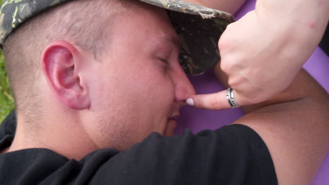 she teasing him while he sleep - toccare con un dito video stock e b–roll