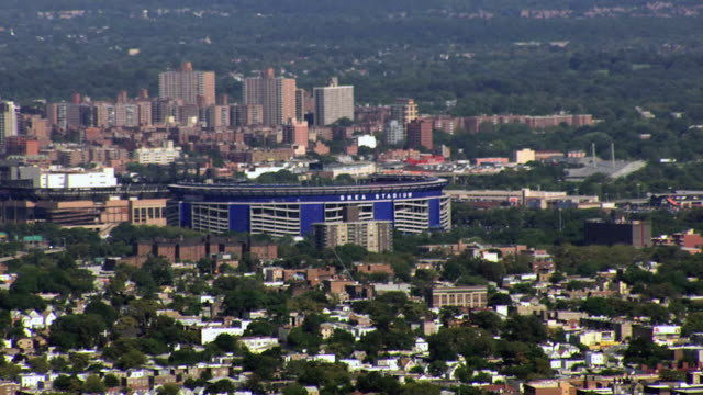 aerial shea stadium and surrounding queens borough / new york city, new york, united states - shea stadium stock videos and b-roll footage