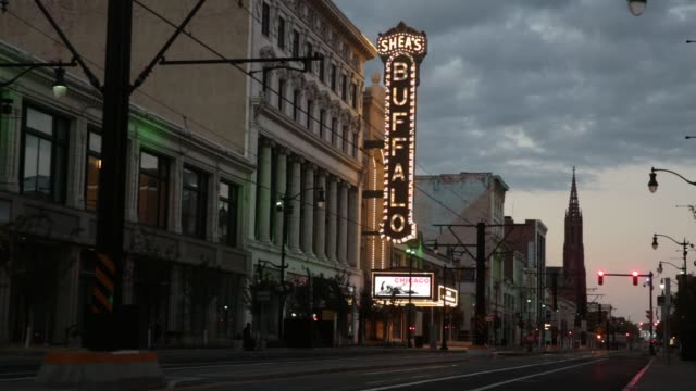sheas performing art center stands along main street in buffalo, new york, us, various shots of the marquee lit up at night, wide shots of vehicle... - buffalo new york state stock videos & royalty-free footage