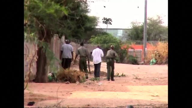 shebab gunmen on thursday seized christian hostages at a kenya university near the border with somalia in an predawn attack that killed at least 15... - violence stock videos & royalty-free footage