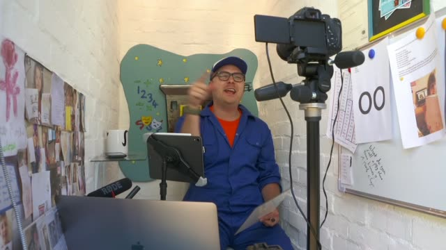 the shed school england ext ashley bates broadcasting lessons over social media from his tiny shed school which has been shortlisted for shed of the... - news not politics stock videos & royalty-free footage