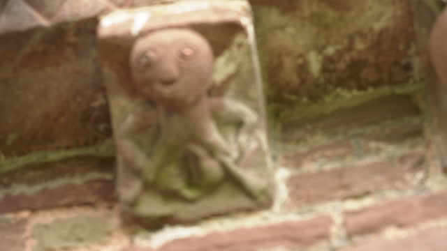 sheela na gig at kilpeck church st mary and st david, herefordshire, uk - carving craft product stock videos & royalty-free footage