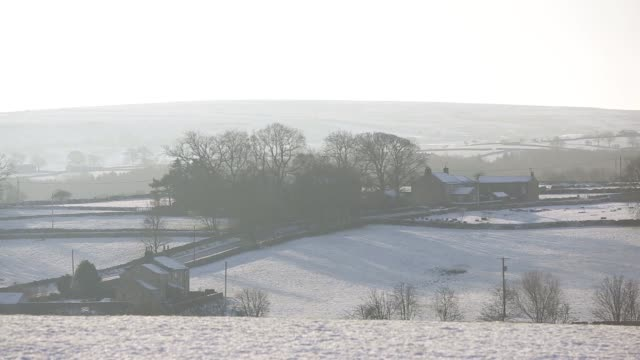 Sheep stand in a snow covered field in Harrogate Yorkshire United Kingdom on Saturday December 27 gvs of the Yorkshire Dales covered in snow gvs of...