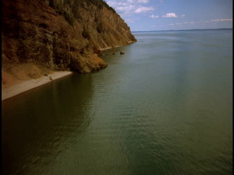 Sheer cliffs border the Bay of Fundy in Canada.