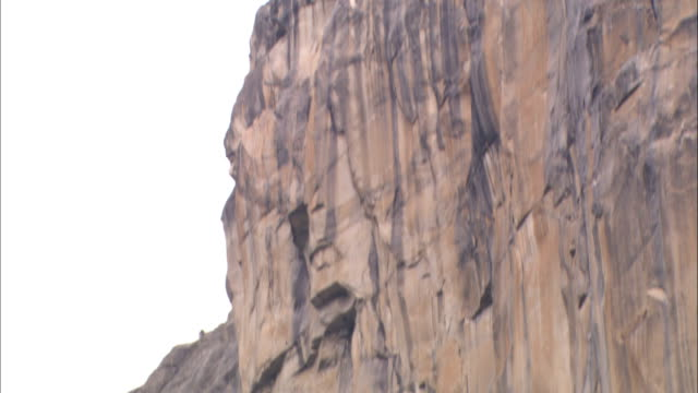 sheer rock faces form the el capitan formation in yosemite national park. - yosemite national park stock videos & royalty-free footage