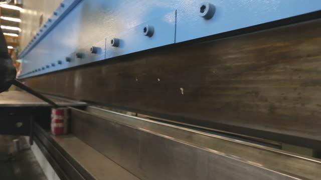 sheet metal bending in factory - bending stock videos and b-roll footage