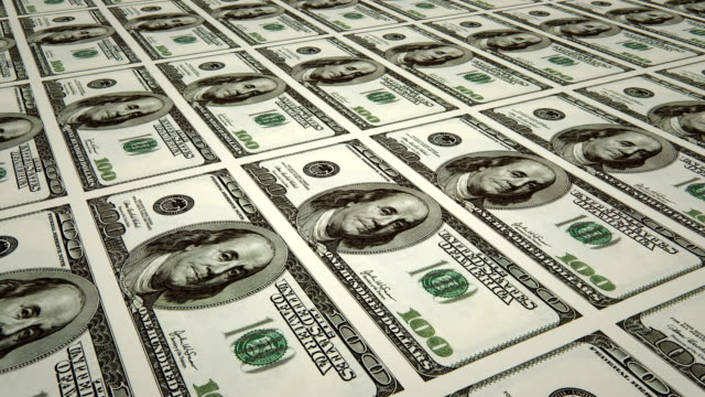 sheet of $100 bills / printing dollar bills (loopable) - currency stock videos & royalty-free footage