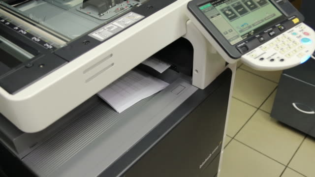 sheet of paper being scanned on a scanning and copying device - fax machine stock videos & royalty-free footage