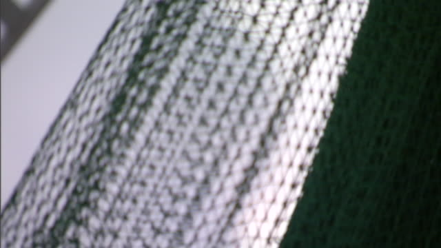 a sheet of silver wire netting lies on a table. - netting stock videos & royalty-free footage