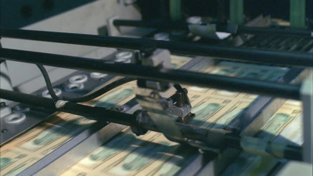 cu, sheets of american ten dollar bills moving fast on conveyor, washington dc, usa - money press stock videos and b-roll footage