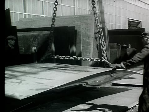 sheets of metal are lifted by a crane at a shipyard in belfast. - shipyard stock videos & royalty-free footage