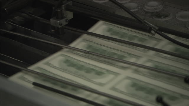 sheets of money run through a printer. - money press stock videos and b-roll footage