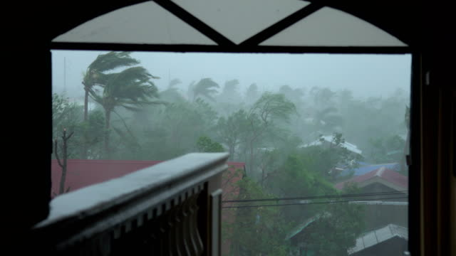 sheets of rain blow past broken window as super typhoon mangkhut hits philippines - isola di luzon video stock e b–roll