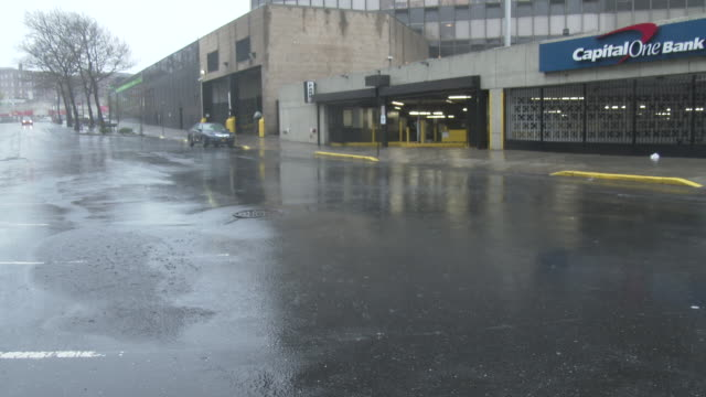 sheets of wind driven heavy rain sweep down an empty junction boulevard during a spring coastal storm in the elmhurst neighborhood of queens new york... - scott mcpartland stock videos & royalty-free footage